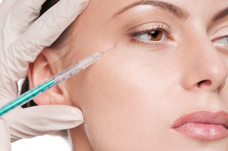Cosmetic botox injection in the female face. Eye zone. Isolated